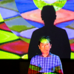 Image: a triptych from a live interdisciplinary performance, showing an individual standing in front of images projected on a screen.