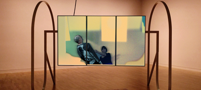 Image: A rectangular screen sits, suspended in air, on a custom-made metal frame within a gallery-like setting. The screen is separated into three parts, with a collage-like image placed within.