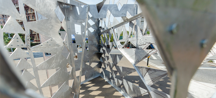 """Image: detail shot of Kenseth Armstead's site-specific installation """"Boulevard of African Monarchs"""" that highlights the aluminum plate construction."""
