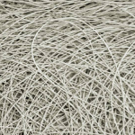 Graphite drawing on paper that mimics a heap of wires