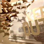 Installation with several cardboard airplanes and the words Keep Out in a room