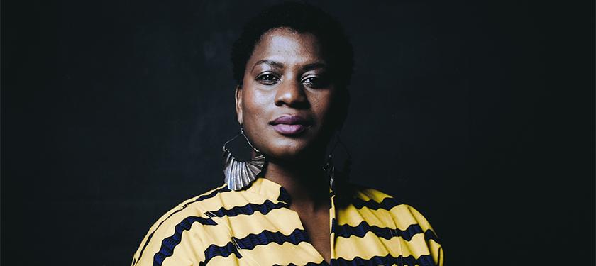 Headshot of Tanika I. Williams over a black background