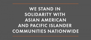 "Image: White text on a grey background that says: ""We Stand in Solidarity with Asian American and Pacific Islander Communities Nationwide."""