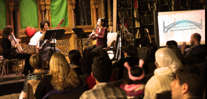 Image: Three women musician performing in front of a crowd in an intimate performance venue just before the New York City shuttered due to the pandemic.