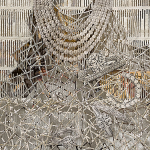 A newspaper spread hangs from a white library newspaper stick. The spread has been restructured without images. Each line of text has been removed with an X-ACTO knife and is collaged back in as a web of text falling from the gridded lace of the layered pages.