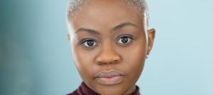 Headshot of Hope Olaidé Wilson over blue/gray background