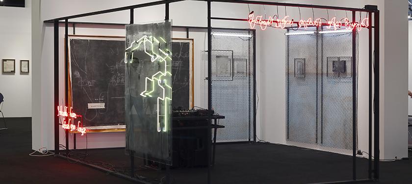 Installation of mesh screens, neon lights, DJ mixer, and speakers