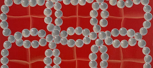 A red painting with white pearl circles interconnected to each other forming 3 loop shapes vertically and 4 loop shapes horizontally.