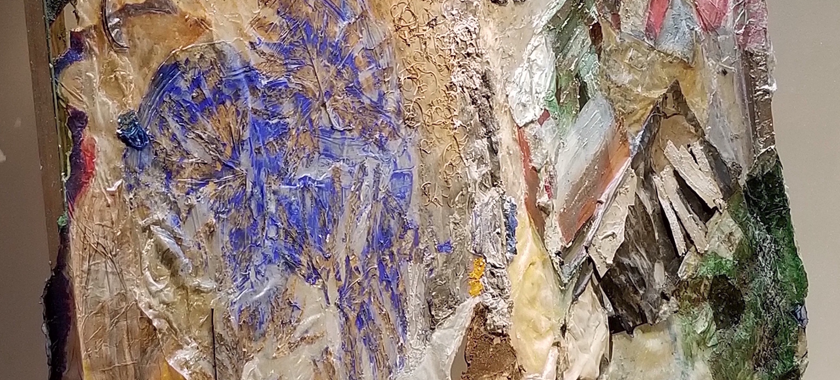 Image Detail: A torn and re-worked painting made of acrylic, acrylic media, mixed papers, wood, textiles, netting, Redbud leaves, leaves, and stems developed from a drawing and from an earlier work-in-progress that becomes a fusion of intertwining shapes of leaves with a partial figure drawing and draped acrylic pyramid at the top (not pictured).